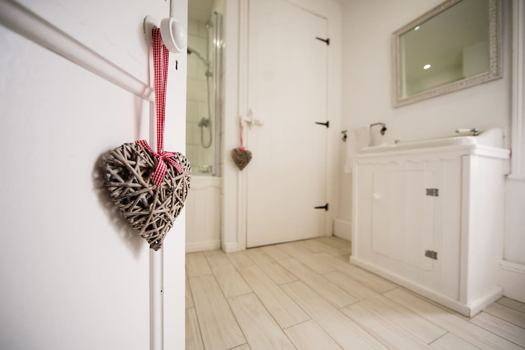 Main bathroom with deep, original bath with power shower over. Ensuite or can be shared with twin room if a family are visiting.