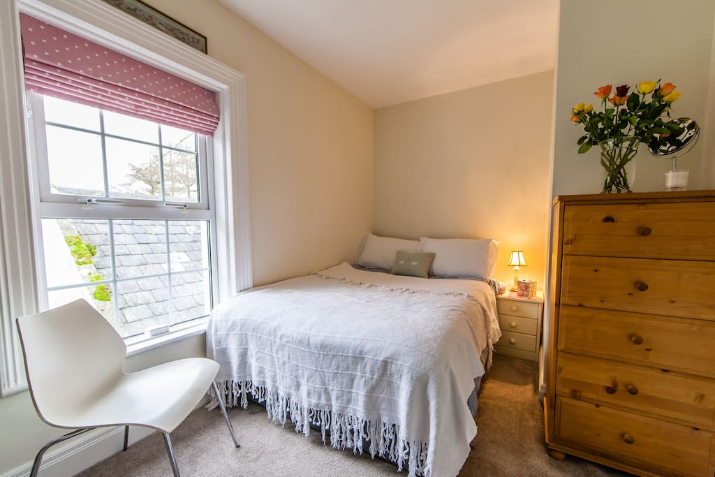 A double bedroom which has been newly decorated with pretty views of our garden.