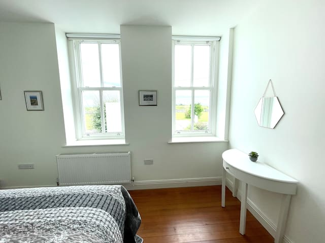 Bedroom 2 has spacious fitted wardrobes & garden views.