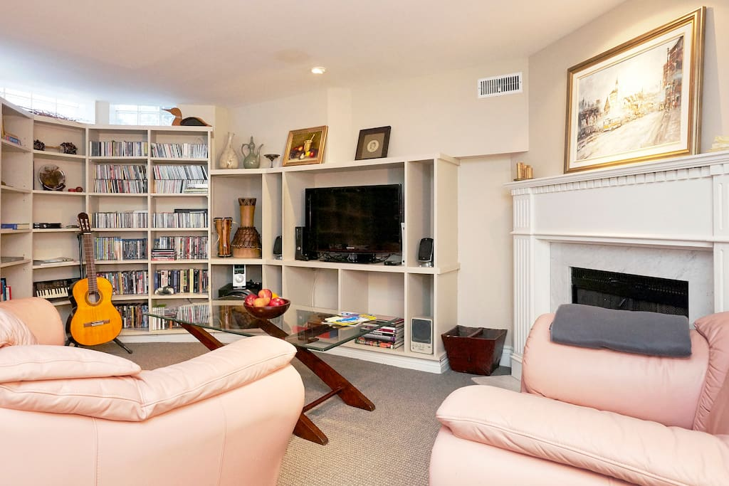 Your private living room with TV. (The fireplace pictured is not in use, but you're welcome to enjoy the fireplace on the main floor!)