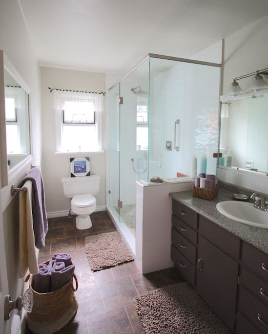 A spacious, well equipped bathroom, including a hair dryer, walk in shower and plenty of thirsty towels!