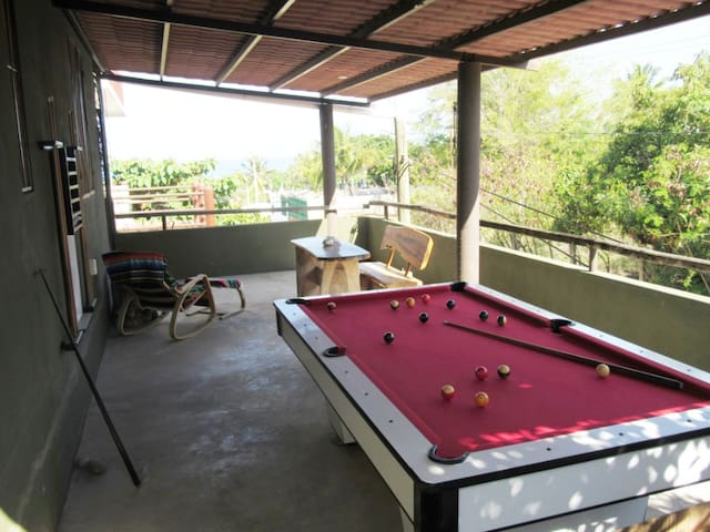 Play a game of pool, watch the sunset or just relax on the shared game deck.