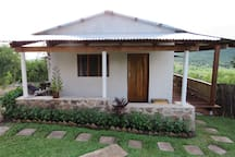 Lakeview Cottage: Bedroom 2 with 3 x single beds each with shared shower + toilet, kitchen and veranda.