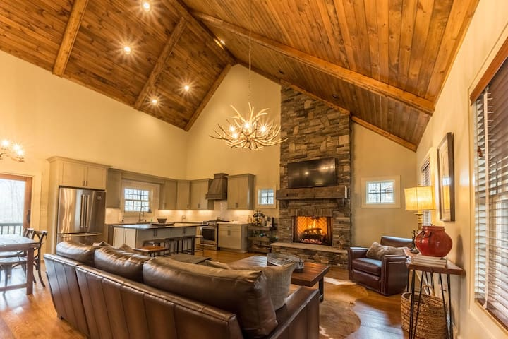 Living room with seating and gas log fireplace