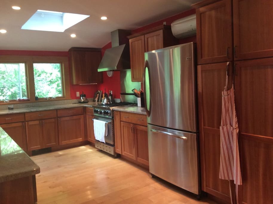 cook's kitchen w/ gas stove, dishwasher, skylight