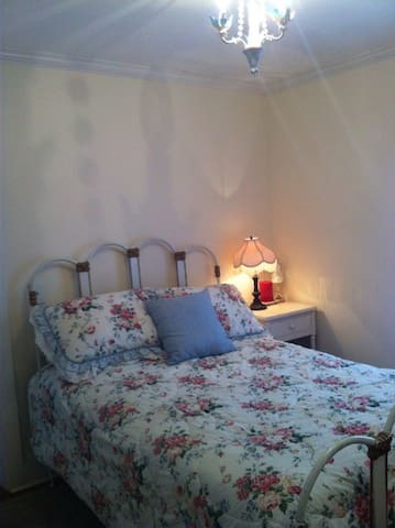 Quiet back bedroom with beautiful antique bed (Full) and dresser.