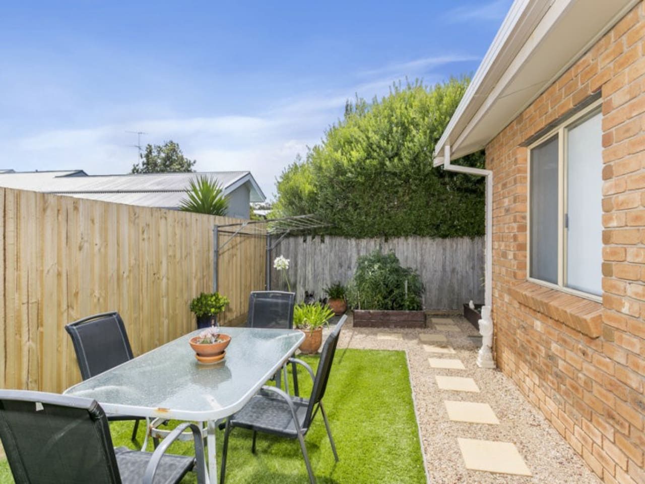 The L-shaped backyard faces north and is the perfect area for sun drenched BBQs and outside dining.