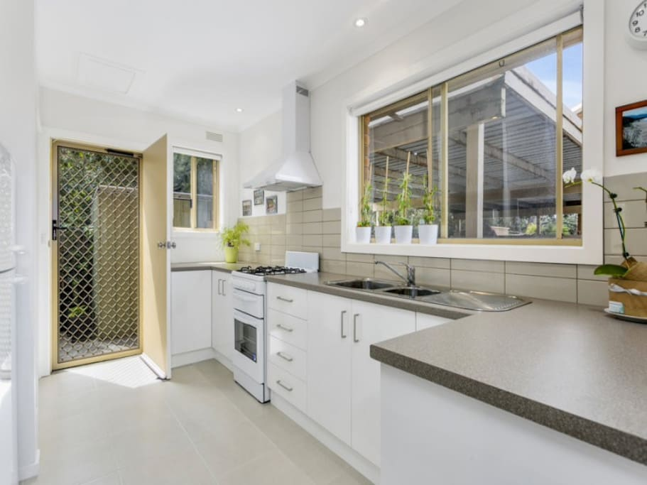 The kitchen boasts functional bench space and is ideal for family catering. Gas cooking and direct access to outdoor entertaining encourages regular use of this private family space.