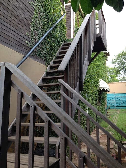 Off street drive in access to open parking and stairs leading to upper unit