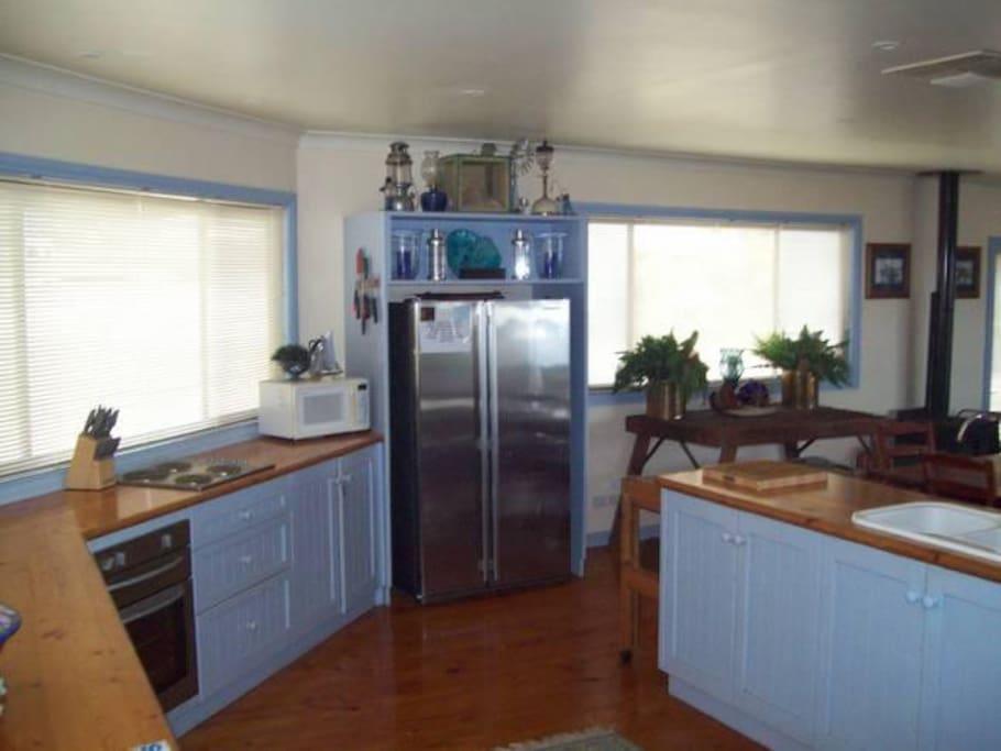 Open plan, well-stocked kitchen