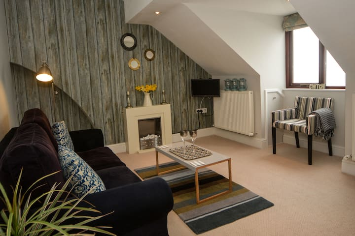 This is the living room, with the sofa bed , incredible sea views with promise of famous Aberystwyth sunsets