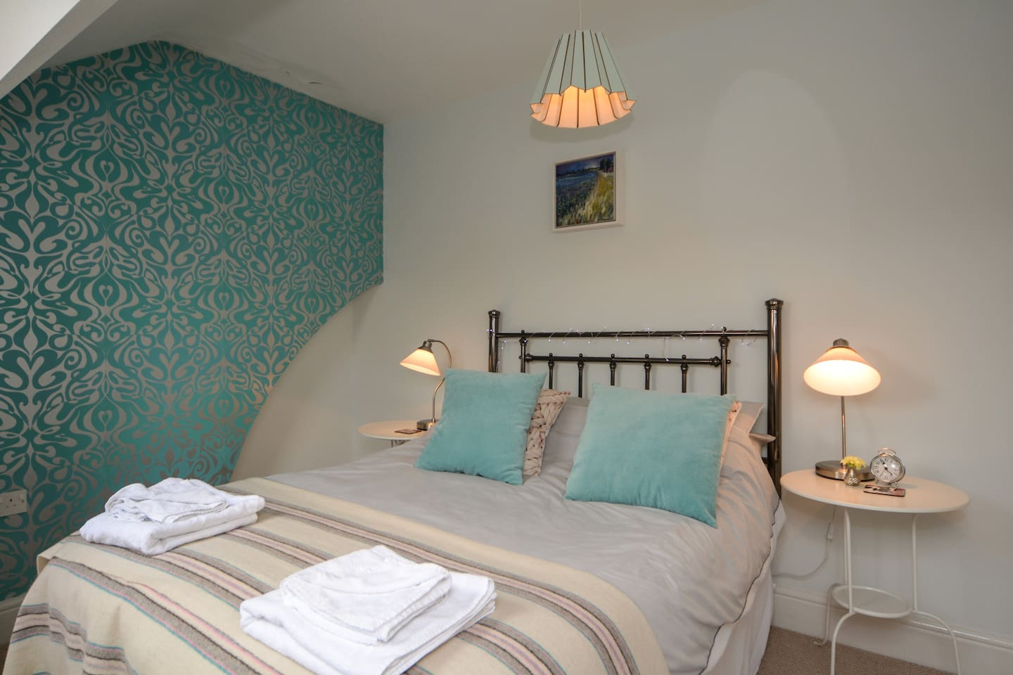 This is the Bedroom overlooking the harbour , room for travel cot