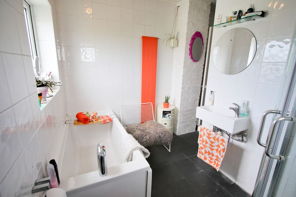 Shared bathroom with bath, shower and sink. Towels will be supplied.