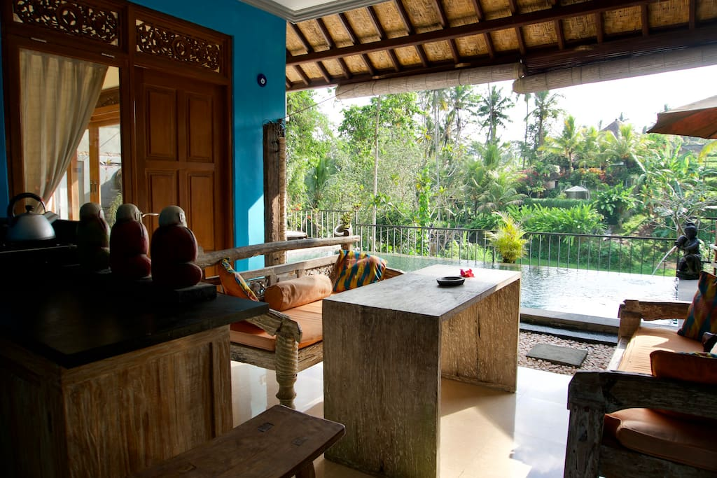 Private guest suite with terrace and kitchen overlooking shared pool area
