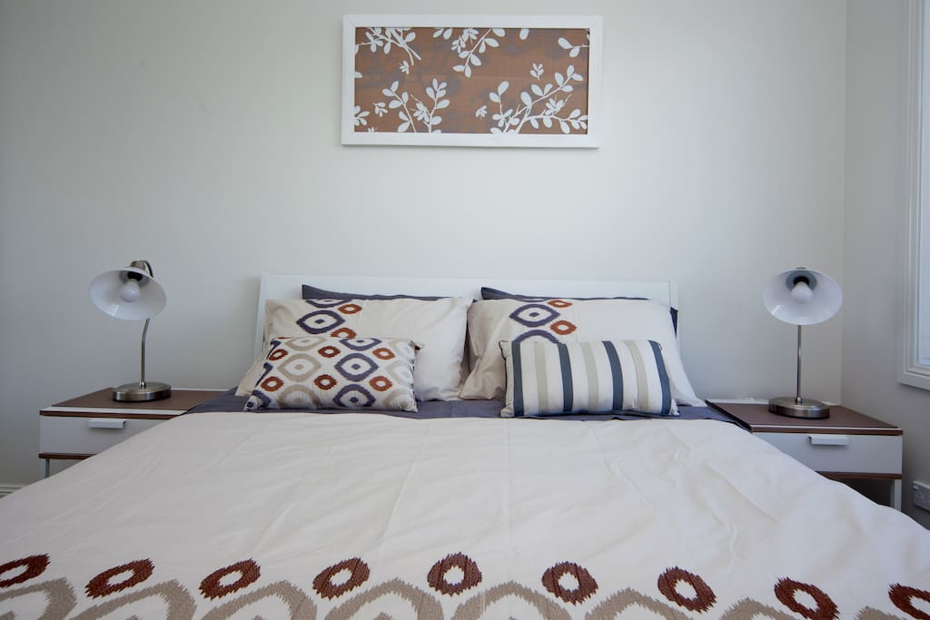 Comfortable queen size bed with matching side tables