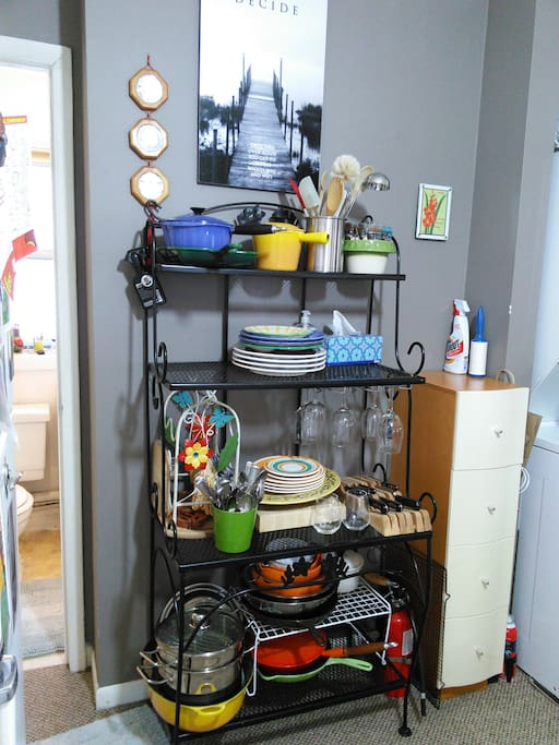 Baker's rack in the kitchen with pots, pans, and dishware