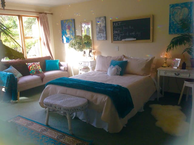 Lovely sunny guest room with comfortable sofa.