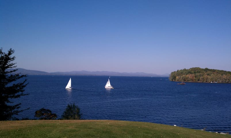 Sailing on The Great Sacandaga - View from the lawn with Scout island to the right.