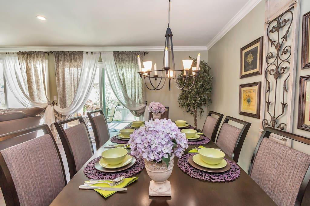Elegant dining table for 8 under a light chandelier