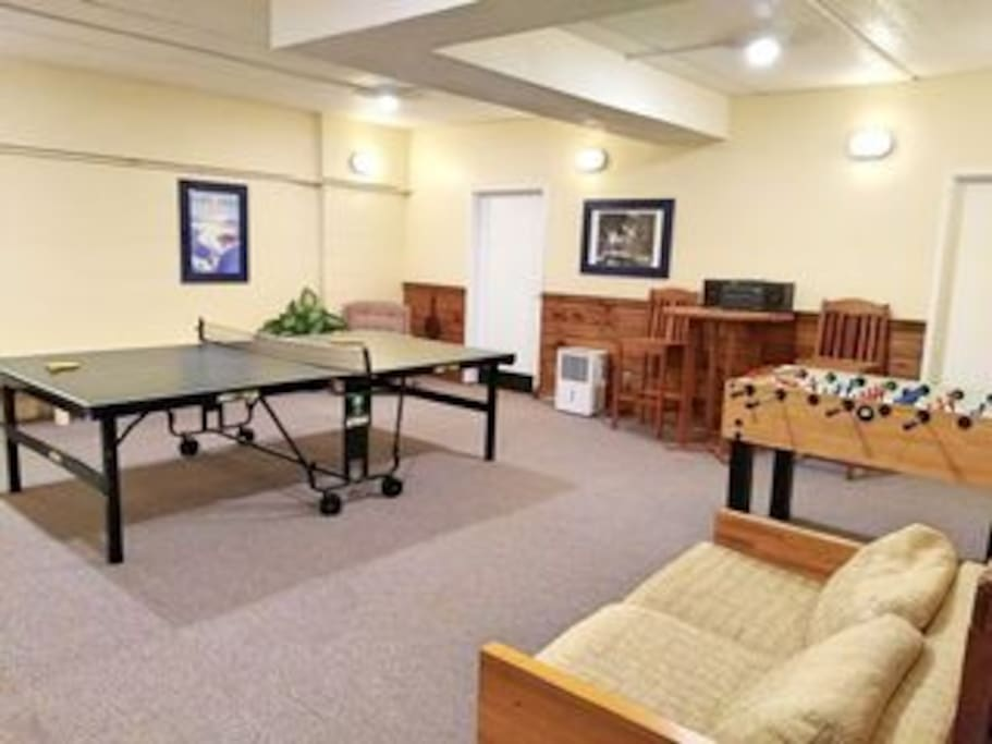 Shared game room for the building, complete with ping pong, foosball, and table shuffleboard (not shown), just a short walk down the hall from the apartment