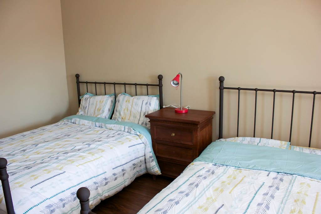 2 queen size beds with high quality memory foam mattresses.