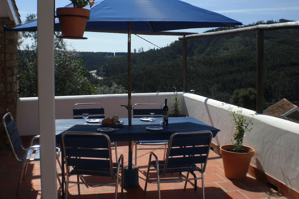 Take in the mountain views from the large, first-floor veranda with dining area, seating area and BBQ.