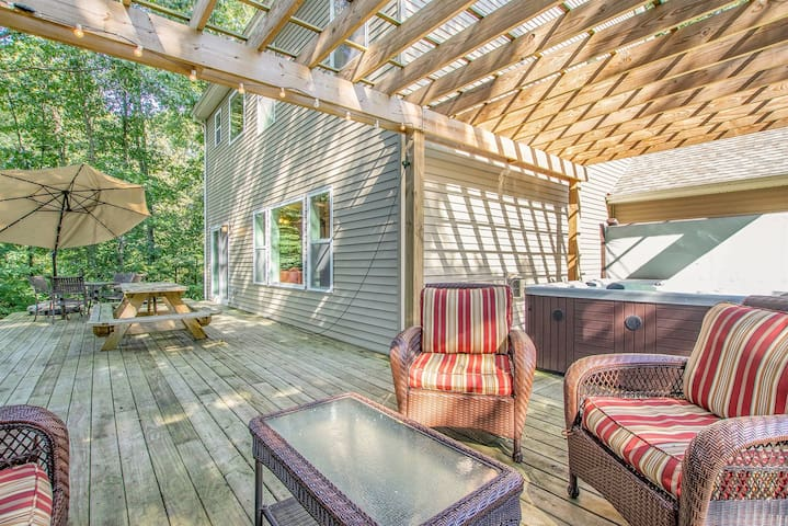 Back deck with hot tub and outdoor furniture