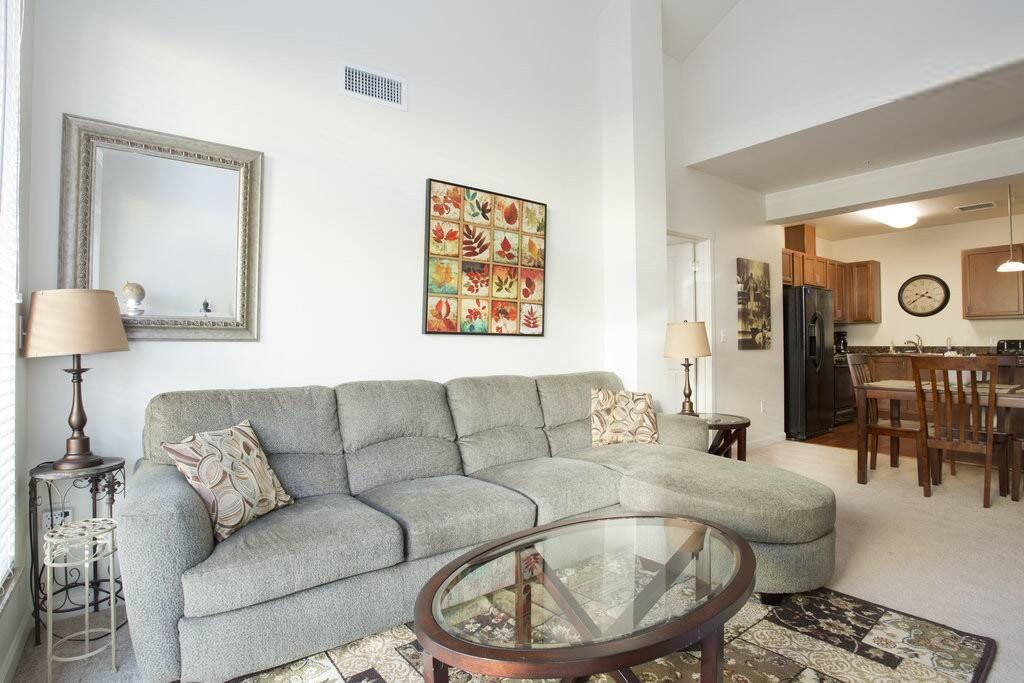 Living room w/ large comfortable sofa