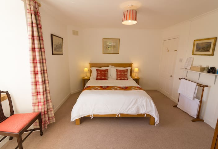 Your light and cosy double bedroom features en-suite facilities (WC & shower) and lovely open views across Moine Mhor towards the Crinan Canal and Knapdale Forest.