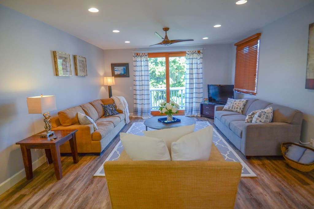 Roomy living area for family and friends to gather after a day at the beach. Directly off living room is patio and gas BBQ