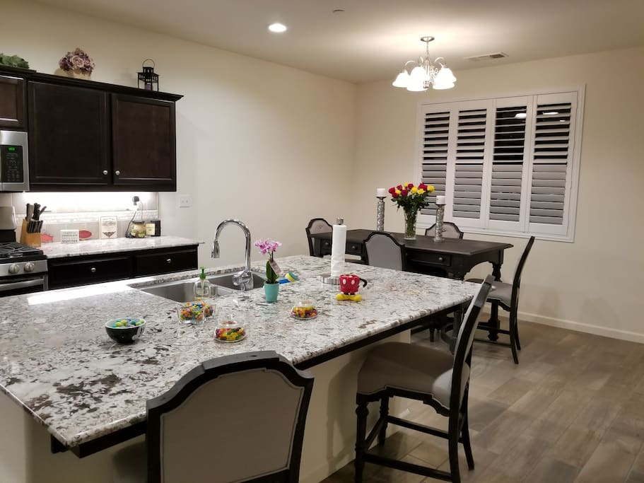 Kitchen island is open to the dining area and living room and always has tasty snacks such as candy and chocolate. Enjoy :)