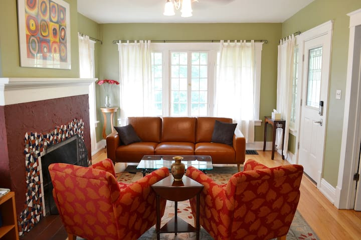 Colorful living room welcomes you when you come in the front door.