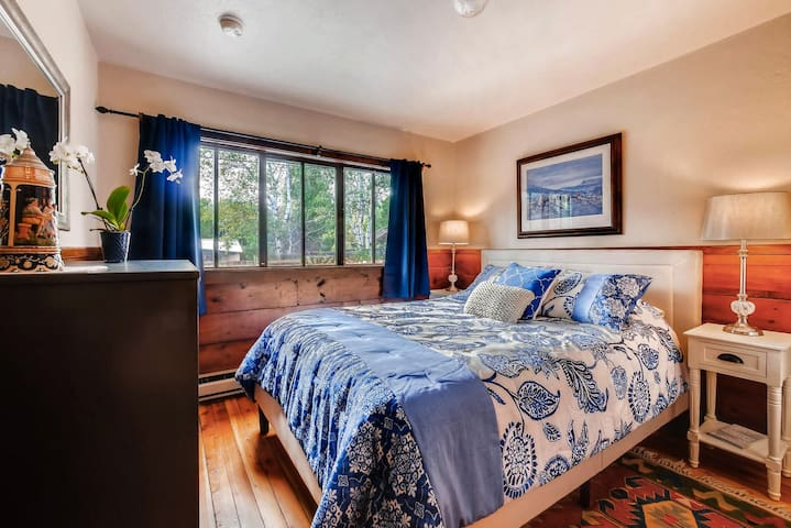 Cozy Colorful Queen Bedroom with lots of light and blackout curtains