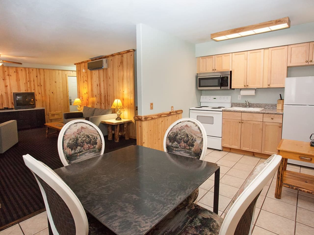This townhome features a full kitchen, dining area, and living room.