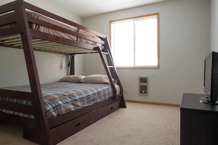 High-end mattresses and wider bottom bunk provide comfortable sleeping for adults or children
