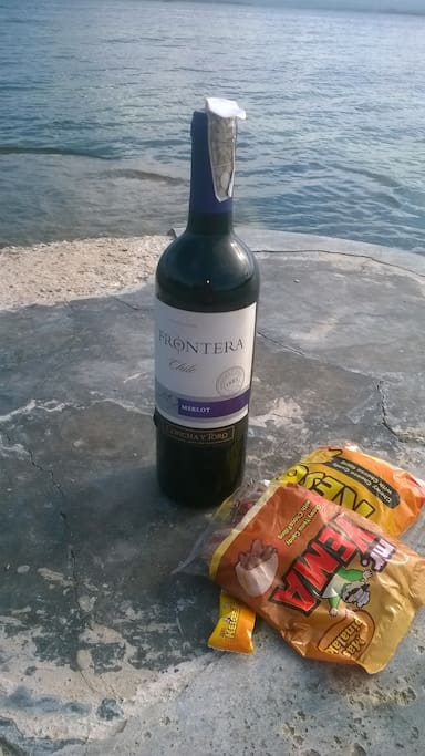 bring your owned wine and in joy beach without any charge..