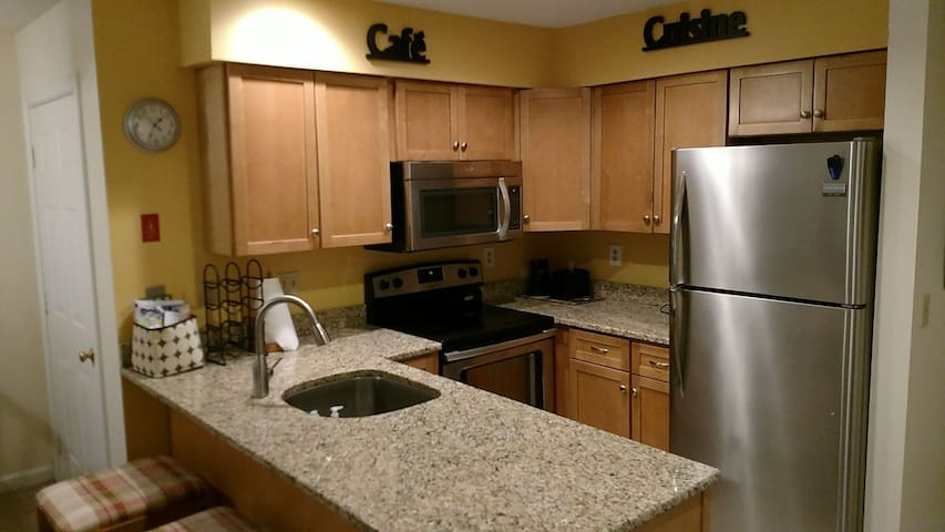Complete kitchen w stove, microwave, dishwasher, fridge, toaster, coffee maker, cookware, cutlery, dishes etc.