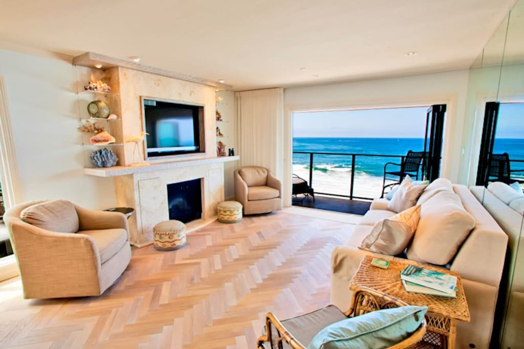 Top floor condo has full ocean views, balcony, fireplace and flat screen TV with sofa