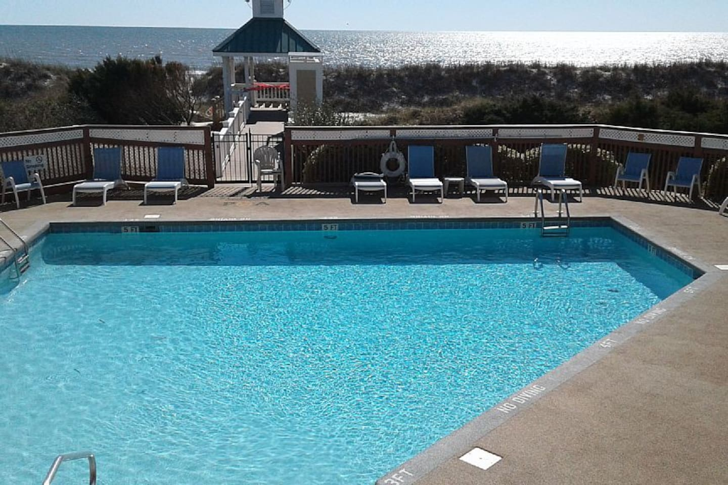 Private Beach Club pool overlooking the ocean. with bathrooms and private parking.,