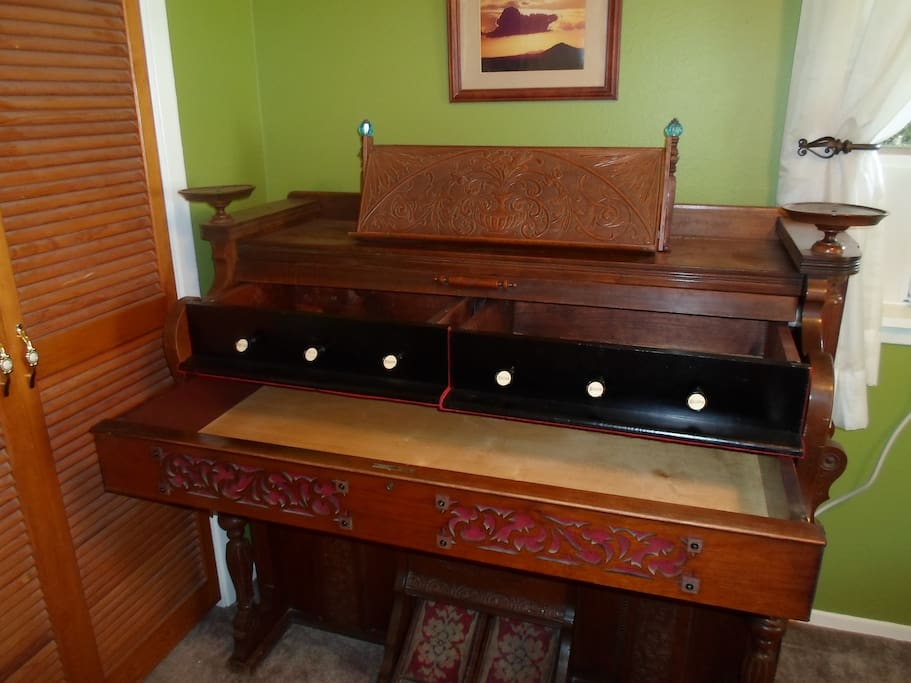 Organ converted to a dresser and a walk in closet