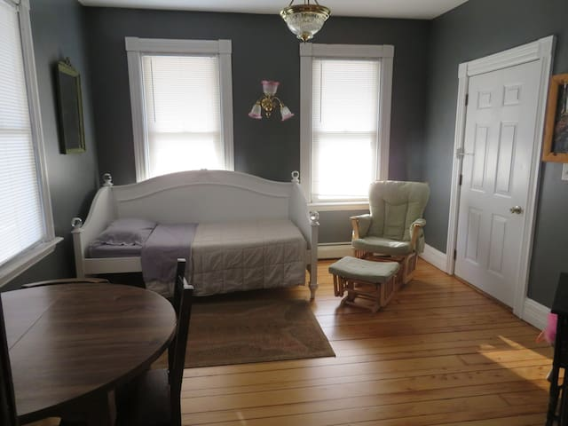 The Parlor room is used as a third bedroom and has a twin bed.