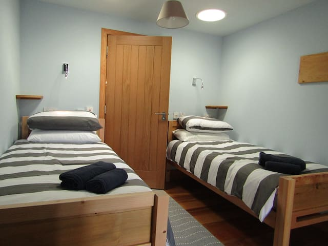 Twin beds made with Fingask wood