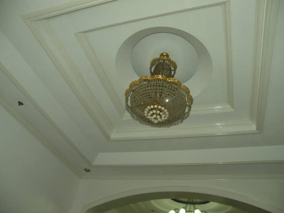 Spacious Living Area ( High Ceiling) Accented with Swarovski  Chandelier