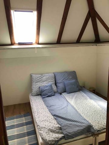 Small bedroom for two. Can be set as two single beds or a king bed.