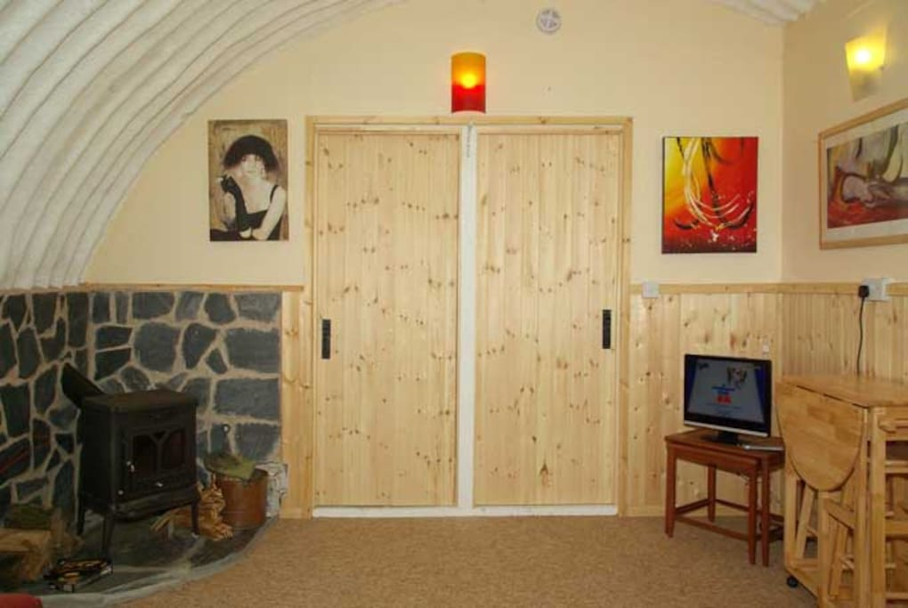 log burner with entrance to the bedrooms