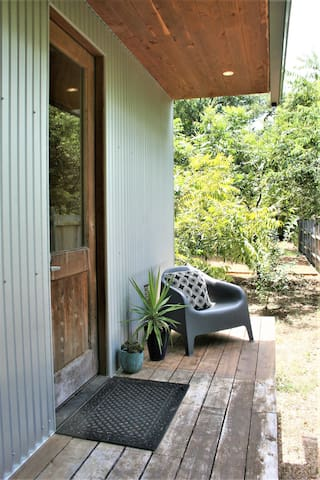 Private front porch, no neighbors on this side so it feels very secluded.