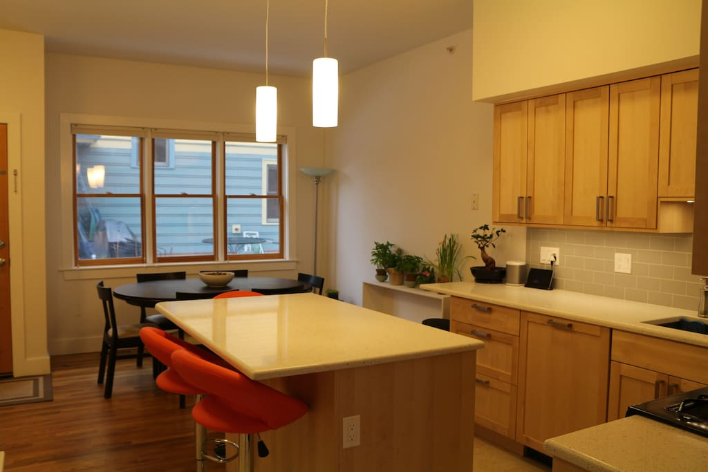 Open kitchen / dining room, with seating just outside the back door for meals al fresco.