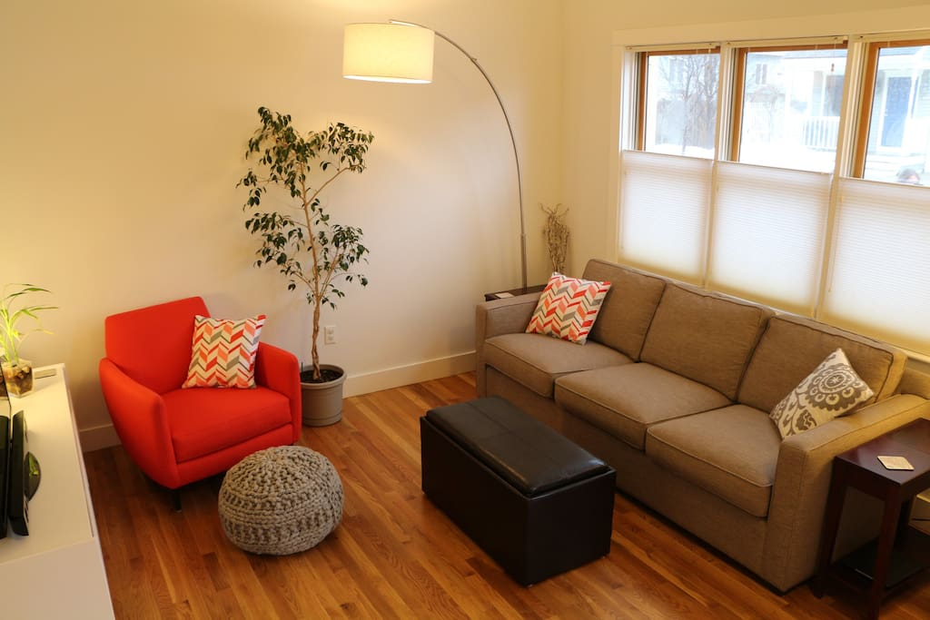 Living room with television and flexible seating.