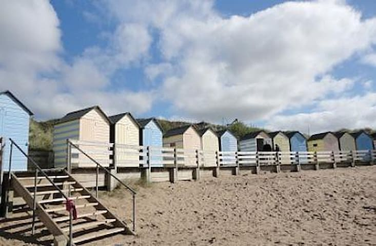 Located just minutes from these beautiful beach huts and the golden sand