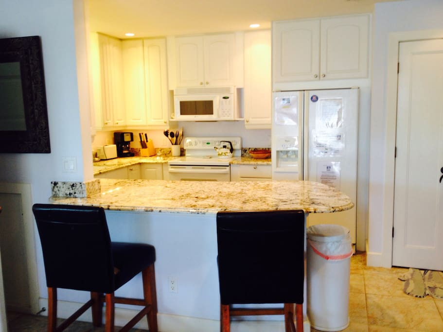 Lovely granite kitchen with bar and chairs
